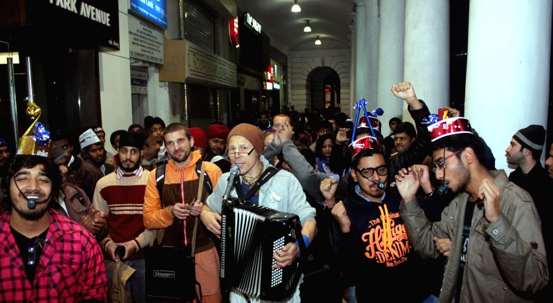 People celebrate on new year's eve at Connaught Place in New Delhi, on Dec 31, 2014.