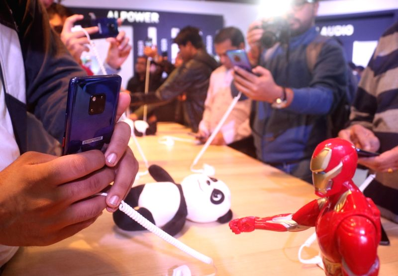 New Delhi: People checkout the newly launched Huawei Mate 20 Pro in New Delhi, on Nov 27, 2018. (Photo: IANS)