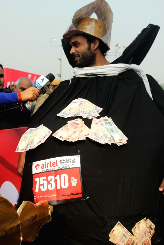 People during Airtel Delhi Half Marathon at Jawaharlal Nehru Stadium in New Delhi on Nov 23, 2014.