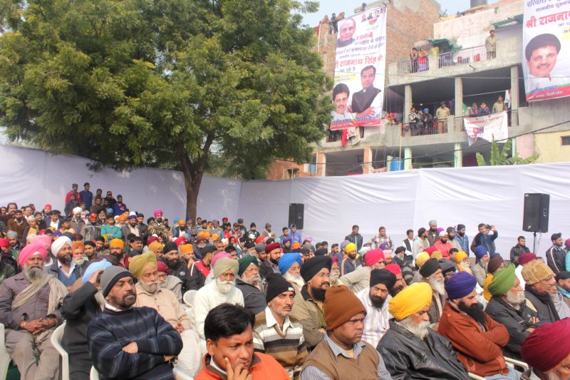 People during during a programme organised to distribute enhanced compensations to people affected by the 1984 anti-Sikh riots at Widow Colony Tilak Nagar, New Delhi  on Dec 26, 2014.