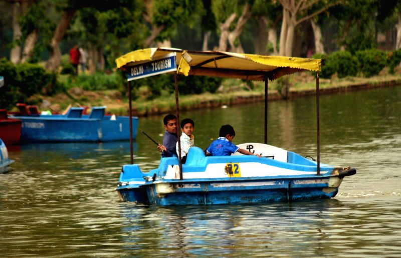 People enjoy boating on an overcast day in New Delhi on April 13, 2015.