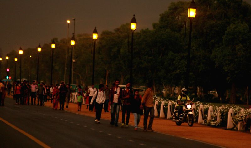 People enjoy evening stroll on Raj Path  on an overcast day in New Delhi on April 13, 2015.
