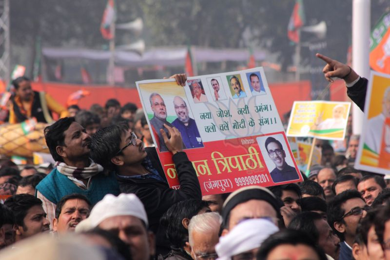 People gather at a BJP rally to celebrate party's success in the recently concluded assembly polls in Jharkhand and Jammu and Kashmir at Ramlila Maidan in New Delhi on Jan 10, 2015.