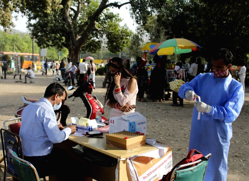 New Delhi: People getting tested during the Case increase of Coronavirus at India Gate in New Delhi on Saturday 20 March, 2021.(Photo:IANS/Qamar Sibtain)