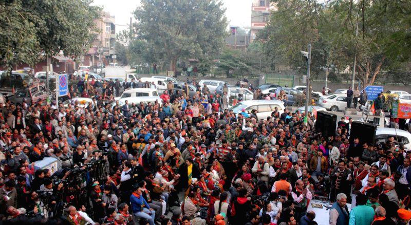 People participate in a BJP roadshow in Rohini, New Delhi on Jan 19, 2015.