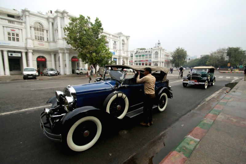 People participate in a vintage car rally organised at Baharakhamba Road in New Delhi, on March 8, 2015.