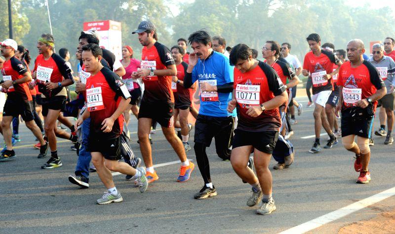 People participate in Airtel Delhi Half Marathon at Jawaharlal Nehru Stadium in New Delhi on Nov 23, 2014.
