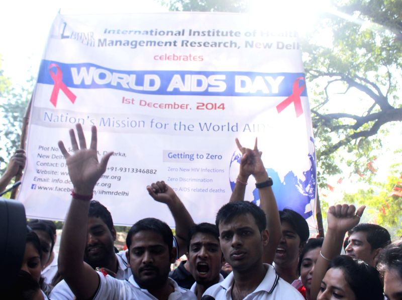 People participate in an awareness rally at Jantar Mantar on World Aids Day in New Delhi, on Dec 1, 2014.