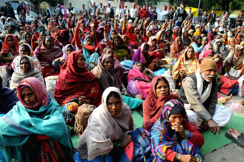 People participate in Van Jan Adhikar rally participate in a demonstration to press for their demands in New Delhi on Dec 15, 2014.