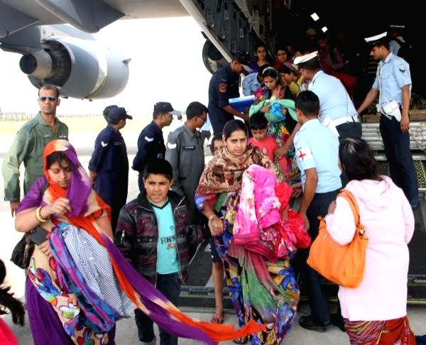 People stuck in earthquake hit Nepal deboard C-17 Globemaster III at Palam Airport, in New Delhi, on April 28, 2015.