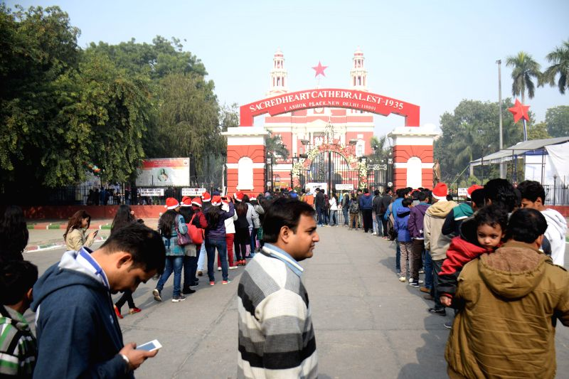 People throng Sacred Heart Cathedral on Christmas in New Delhi, on Dec 25, 2014.