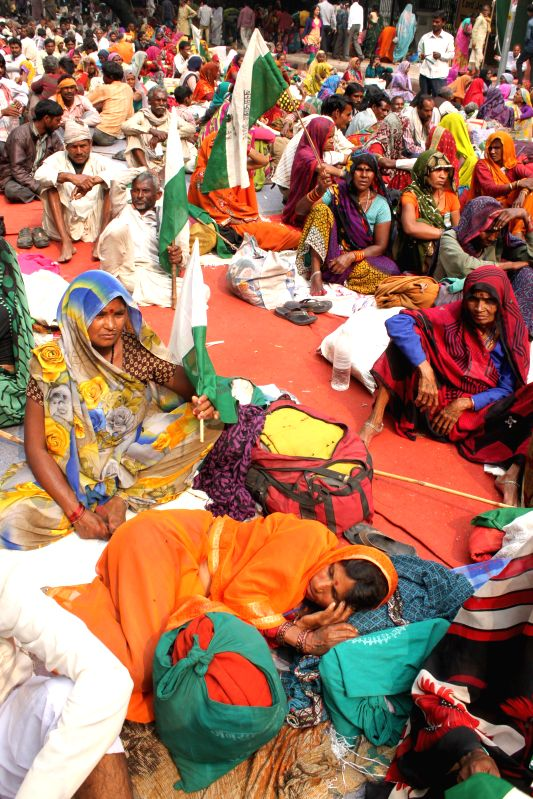 People under the aegis of `Bhoomi Adhikar Sansad` stage a demonstration against the land acquisition ordinance at Parliament Street in New Delhi, on Feb 25, 2015.