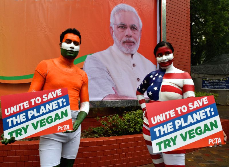 PETA activists demonstrate to urge people to go vegan in New Delhi, on Jan 22, 2015.