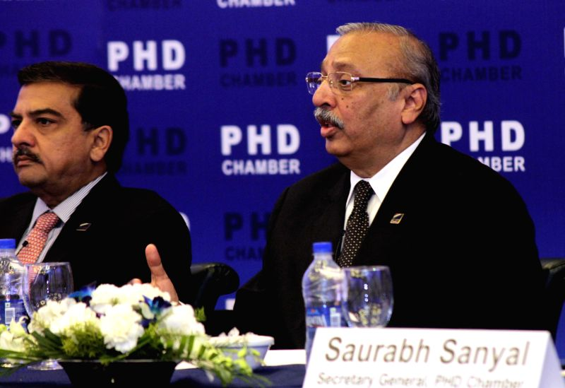 PHD Chamber president Alok B. Shriram and senior vice president of PHD Chamber Mahesh Gupta during a press conference regarding Union Budget in New Delhi, on Feb 17, 2015. - Mahesh Gupta