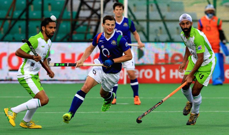 Players in action during a Hockey India League match between Delhi Waveriders and Uttar Pradesh Wizards for the third position at Major Dhyan Chand National Stadium of New Delhi on Feb 22, ...