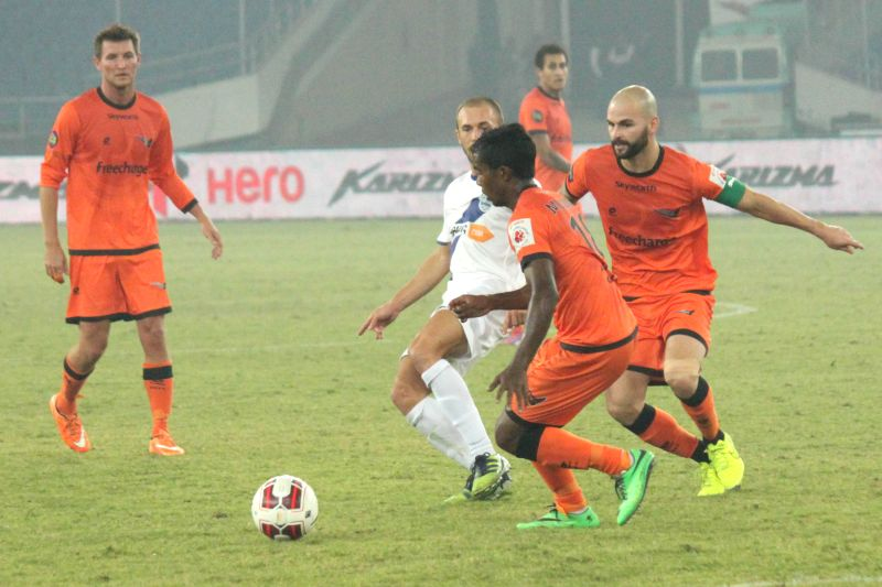 Players in action during an ISL match between Delhi Dynamos and Mumbai City at Jawaharlal Nehru Stadium in New Delhi, on Nov 28, 2014.