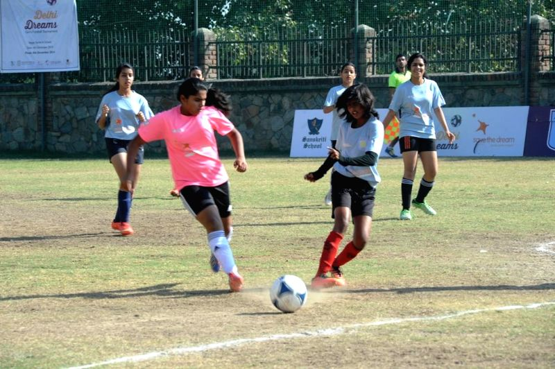 Players in action during the final match of  Delhi Dreams: Girls Football Tournament in New Delhi on Dec 8, 2014.