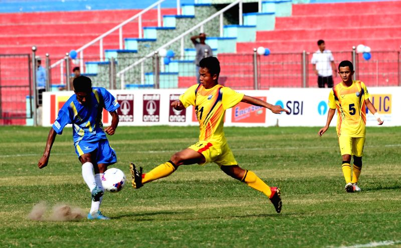New Delhi: Players in action during the final match of U17 Junior Boys Subroto Cup International Football Tournament between Hopewel Elias Higher Secondary School, Meghalaya and Bangladesh Krida ShikshaProthishtan (BKSP) at Dr. Ambedkar Stadium, in N