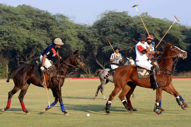 Players in action during the President`s Polo Cup Exhibition match at PBG Parade Ground in New Delhi on Dec. 6, 2014.