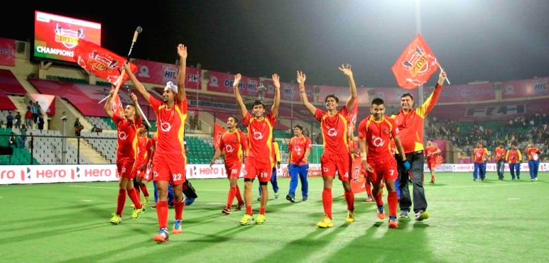 Players of Ranchi Rays celebrate as the team won the third edition of the Hockey India League (HIL) defeating Punjab Warriors 3-2 in a penalty shootout in the final at the Major Dhyan ...