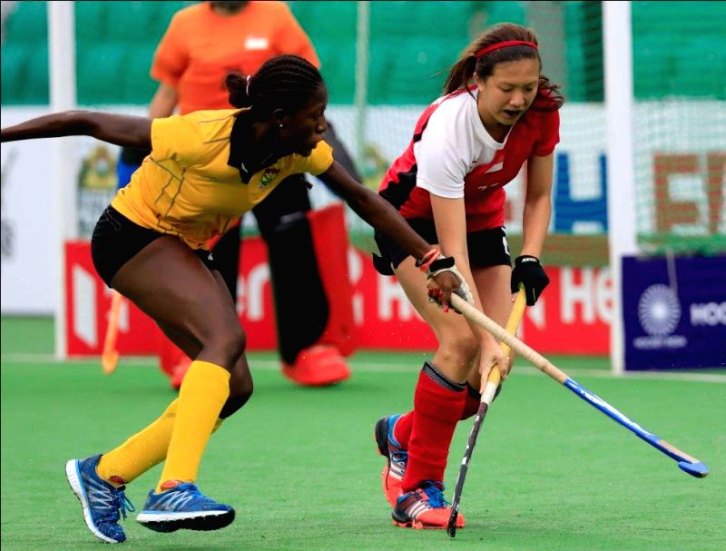 Players of the women team of Ghana and Singapore in action during a match of FIH Hockey World League Round 2 (Women) at Major Dhyan Chand National Stadium in New Delhi on March 15, 2015.