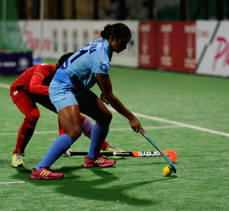 Players of the women team of India and Thailand in action during a match of FIH Hockey World League Round 2 (Women) at Major Dhyan Chand National Stadium in New Delhi on March 14, 2015.