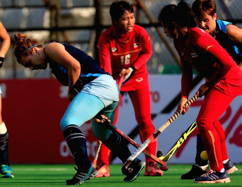 Players of the women team of Kazakhstan and Thailand in action during a match of FIH Hockey World League Round 2 (Women) at Major Dhyan Chand National Stadium in New Delhi on March 12, ...