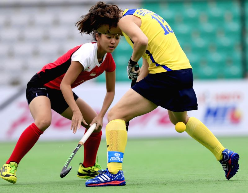 Players of the women team of Kazakhstan and Singapore in action during a match of FIH Hockey World League Round 2 (Women) at Major Dhyan Chand National Stadium in New Delhi on March 14, ...