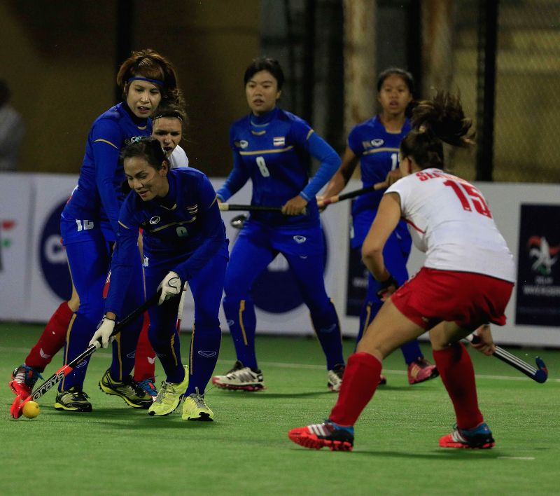 Players of the women team of Poland and Thailand in action during a match of FIH Hockey World League Round 2 (Women) at Major Dhyan Chand National Stadium in New Delhi on March 7, 2015.