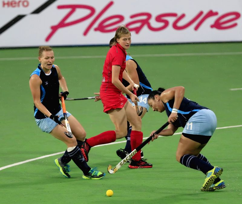 Players of the women team of Russia stuns Kazakhstan in action during a match of FIH Hockey World League Round 2 (Women) at Major Dhyan Chand National Stadium in New Delhi on March 15, ...