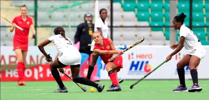 Players of the women team of Russia and Ghana in action during a match of FIH Hockey World League Round 2 (Women) at Major Dhyan Chand National Stadium in New Delhi on March 14, 2015.