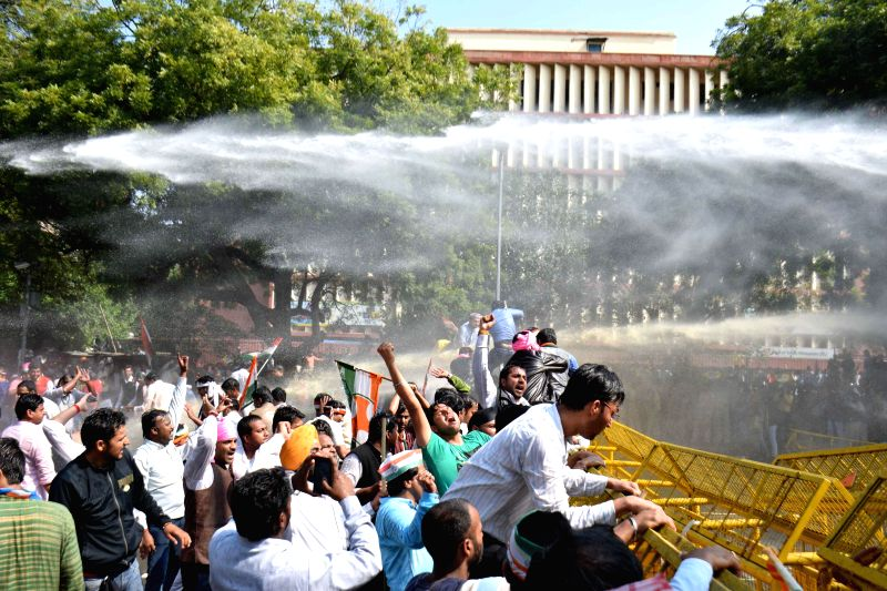 Police charges water cannons of Congressmen demonstrating against the land acquisition bill at Jantar Mantar in New Delhi, on March 16, 2015.