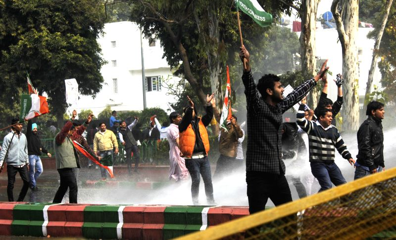 Police charges water cannons on Youth Congress activists staging a demonstration against Union Minister for Communications and Information Technology Ravi Shankar Prasad outside his ...