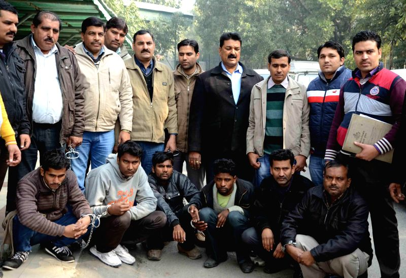 Police presents before press nine people held in connection with fake currency racket in New Delhi, on Jan 13, 2015.
