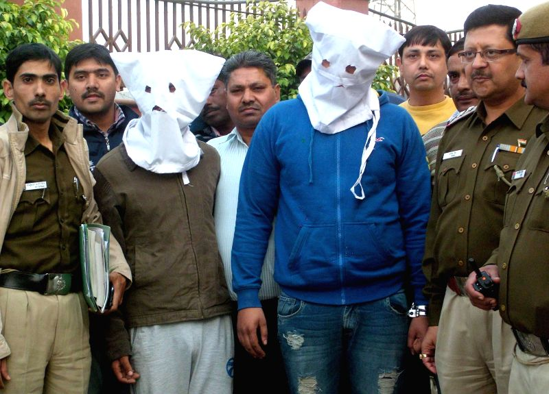 Police presents two people who were arrested in connection with the abduction and murder of the 13-year-old son of a jeweller  before press in New Delhi, on Nov 25, 2014.  Pratap Singh ... - Pratap Singh Sisodiya, Siddharth Sharma and Utkarsh Verma