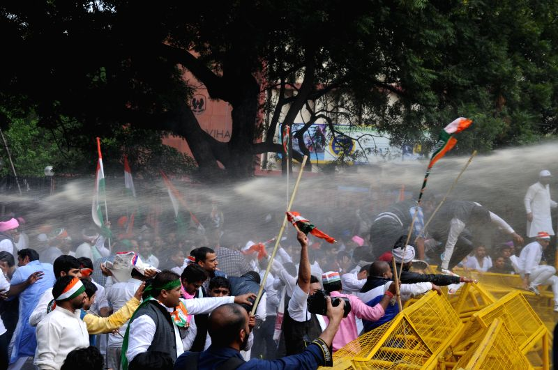 Policemen charge water cannons on Congressmen demonstrating against land acquisition bill at Jantar Mantar in New Delhi, on March 16, 2015.