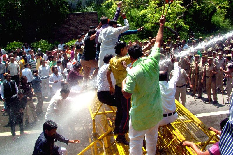 Policemen charge water cannons on BJP workers staging a demonstration against Turkman Gate road rage incident near Delhi Chief Minister Arvind Kejriwal's residence in New Delhi, on April ... - Arvind Kejriwal