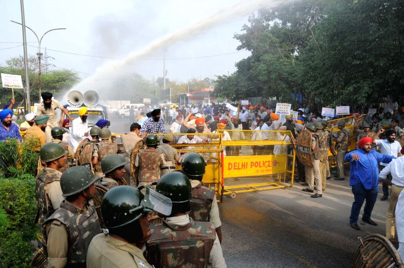 Policemen charge water cannons on the activists of Delhi Sikh Gurdwara Management Committee (DSGMC) and 1984 riot victims staging a demonstration outside the CBI headquarters against the ...