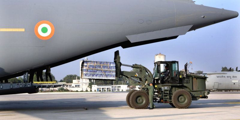 Potable water being loaded in C-17 Globemaster III of the Indian Air Force as a humanitarian assistance from India to Maldives, in New Delhi on Dec 5, 2014.