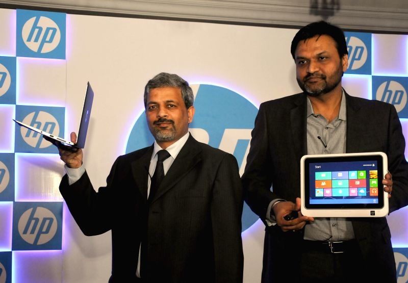 PPS HP India VP and GM Rajiv Srivastava (L) and Director Systems Ketan Patel at the launch of a tablet and a laptop in New Delhi, on April 2, 2015. - Ketan Patel