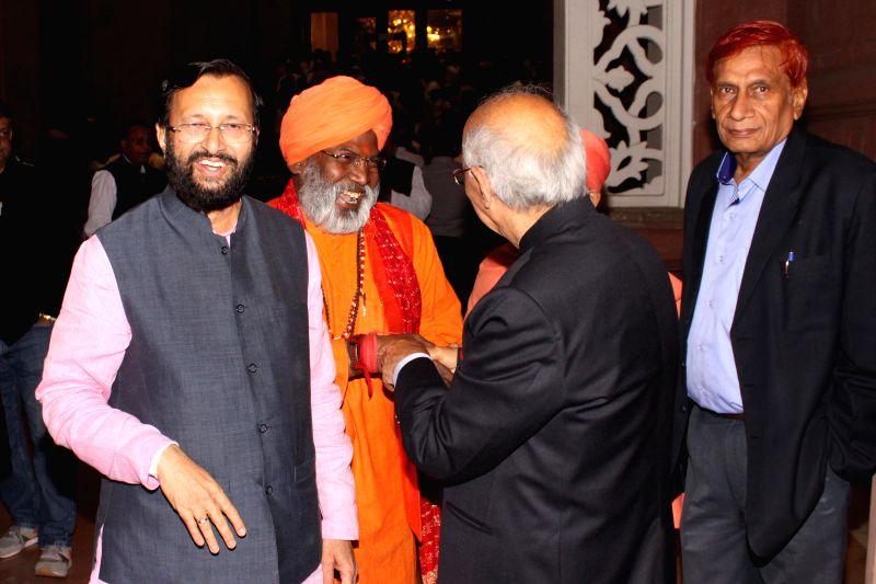 Prakash Javadekar,Minister for Environment and Forest and  Sakshi Maharaj during the  Wedding ceremony of Rashtriya Janata Dal chief Lalu Yadav's daughter Raj Lakshmi with Samajwadi Party ... - Mulayam Singh Yadav and Tej Pratap Yadav