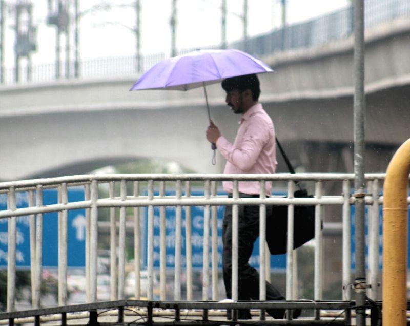 New Delhi: Pre-monsoon showers lash Delhi on June 19, 2017.