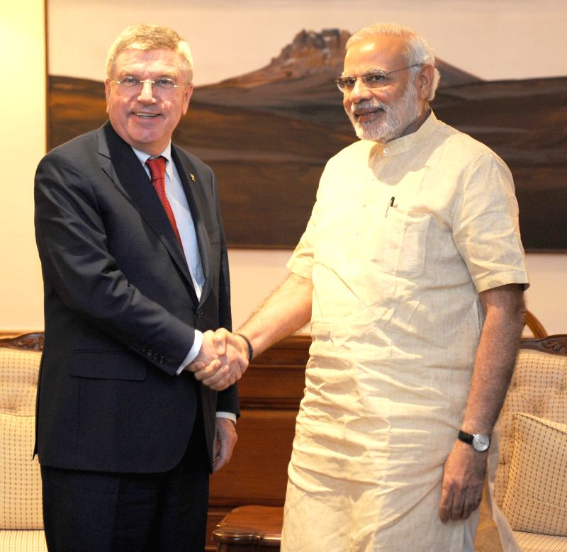 President of the International Olympic Committee (IOC), Thomas Bach calls on the Prime Minister Narendra Modi, in New Delhi on April 27, 2015. - Narendra Modi