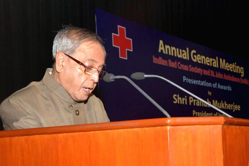 President Pranab Mukherjee addresses during the Annual General Meeting of Indian Red Cross Society (IRCS) and St. John Ambulance (India) at Rashtrapati Bhavan in New Delhi, on Nov 18, ... - Pranab Mukherjee