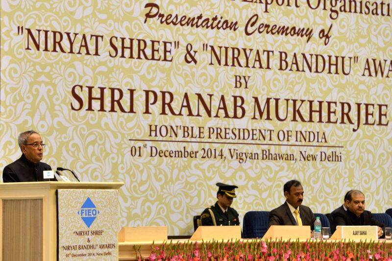 President Pranab Mukherjee addresses during a programme organised to present `Niryat Shree` and `Niryat Bandhu` Awards for the year 2010-11 in New Delhi, on Dec 1, 2014. - Pranab Mukherjee