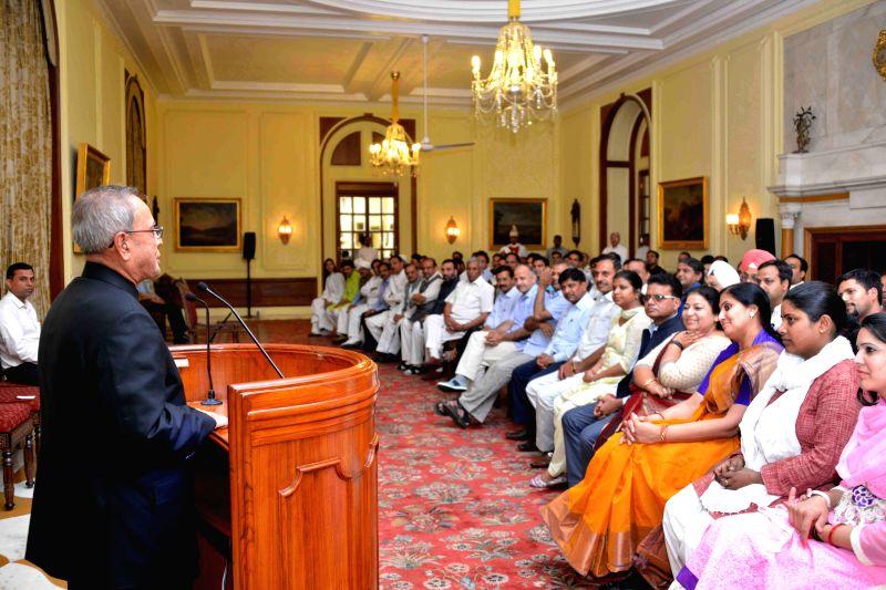 President Pranab Mukherjee addresses Delhi legislators at Rashtrapati Bhawan in New Delhi, on March 27, 2015. - Pranab Mukherjee