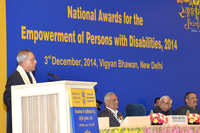 President Pranab Mukherjee addresses at the presentation ceremony of the National Awards for the Empowerment of Persons with Disabilities 2014, in New Delhi on Dec 3, 2014. Also seen the ..