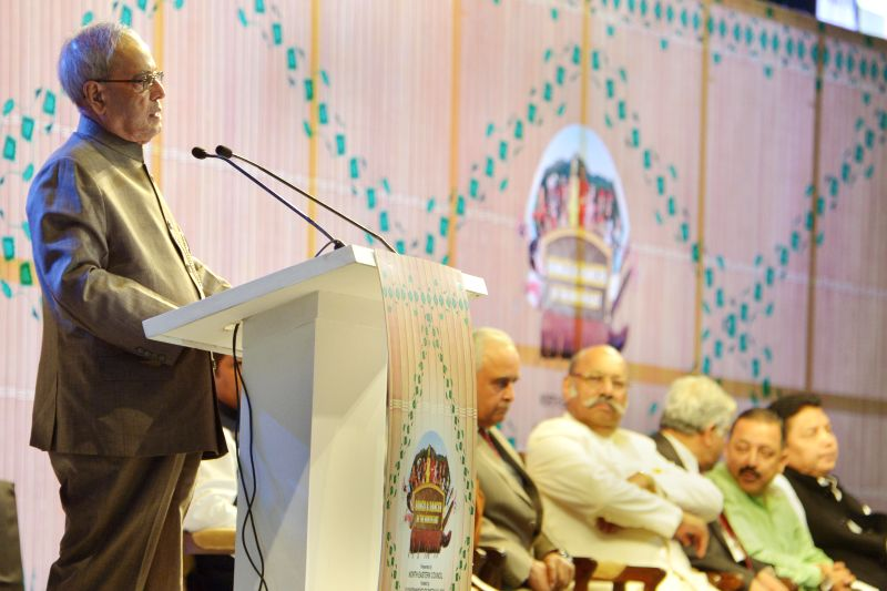President Pranab Mukherjee addresses at the inauguration of the cultural festival `Songs and Dance of the North East`, in New Delhi on April 11, 2015. Also seen The Minister of State for ... - Pranab Mukherjee and Jitendra Singh
