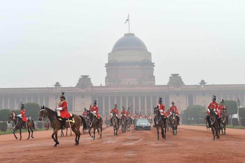 President Pranab Mukherjee and his horse borne bodyguards proceed towards the venue of Republic Day celebrations at Rajpath in New Delhi, on Jan 26, 2015. - Pranab Mukherjee