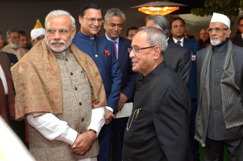 President Pranab Mukherjee and Prime Minister Narendra Modi at the inaugural ceremony of the Ceremonial Hall, at the President's Estate, in New Delhi on Dec 12, 2014. Also seen journalists - Narendra Modi, Pranab Mukherjee and Rajat Sharma